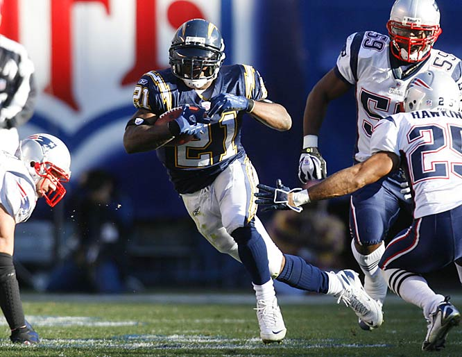 League MVP LaDainian Tomlinson's 187 total yards and two touchdowns were not enough to overcome New England.