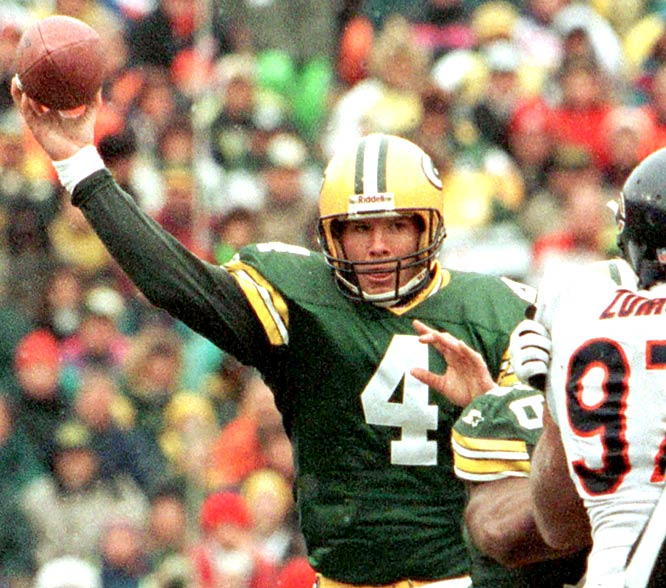 Playing with a sprained ankle, Favre tossed five touchdown passes to help the Packers beat Chicago 35-28.