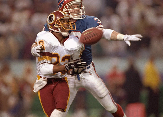 Washington  Redskins receiver  Ricky Sanders making  a reception against Buffalo Bills'  defender Mark Kelso in Super Bowl XXVI.