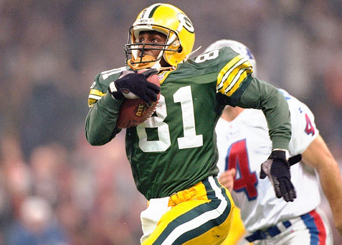 Desmond Howard of the Green Bay Packers returning a kickoff 99 yards for a touchdown in Super Bowl XXXI in 1997. Howard was named MVP.