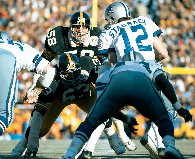 Steelers linebacker Jack Lambert waiting for Dallas Cowboys  quarterback  Roger Staubach  to take the snap in Super Bowl X.