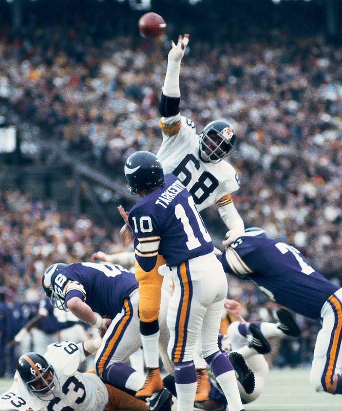 Minnesota Vikings  quarterback Fran Tarkenton  passing against Pittsburgh's L.C. Greenwood in Super Bowl IX.
