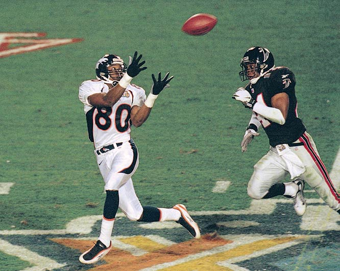 Broncos wide receiver  Rod Smith (80) catches a TD pass as Falcons free safety Eugene Robinson (41) trails in the second quarter of Super Bowl XXXIII.