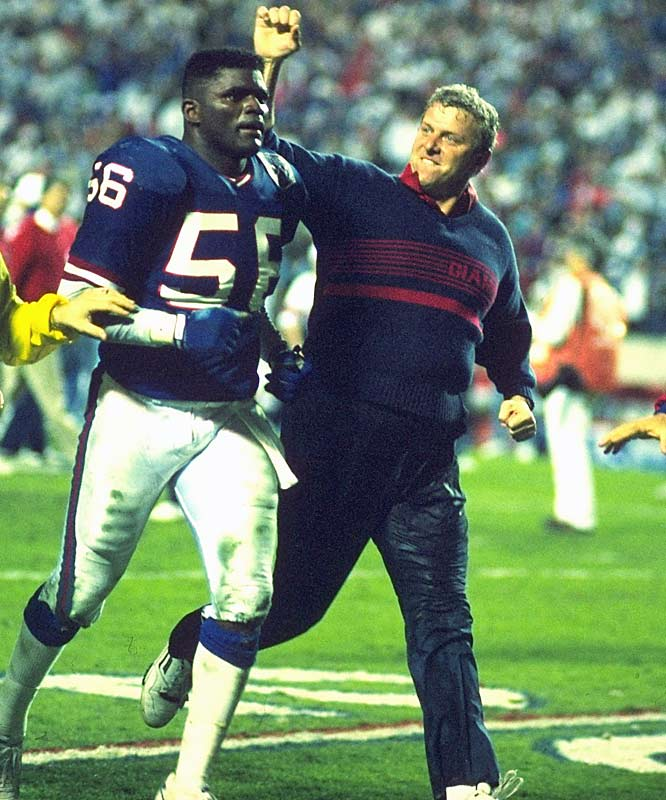 In 19 years of coaching, Parcells' best defensive player was Lawrence Taylor, seen here celebrating with Parcells after winning Super Bowl XXV.