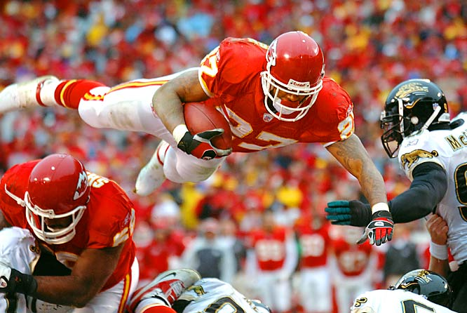 Larry Johnson flies into the end zone for the first of his three touchdowns against Jacksonville. Johnson rushed for 138 yards while setting an NFL record for carries in a season.