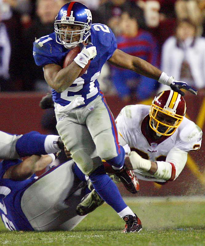 Tiki Barber rushed for a franchise record 234 yards and scored three touchdowns in what may have been his last regular-season game.  The Giants will play the NFC East champion Eagles in Philadelphia this Sunday.