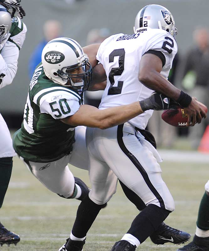 Linebacker Eric Barton sacks Raiders quarterback Aaron Brooks and forces a fumble in the Jets victory over Oakland.  The Jets clinched a playoff berth with the win and will play the AFC East champion Patriots in New England this Sunday.
