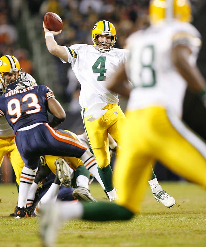 Brett Favre passes to wideout Carlyle Holiday during Green Bay's win over Chicago.  Favre threw for 285 yards and a touchdown in what might have been the last game of his illustrious NFL career.