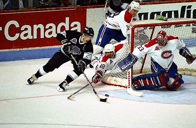 Robitaille's 63 goals and 123 points -- the most ever by a left winger, powered the Kings into the 1993 playoffs where they reached the Stanley Cup Finals.