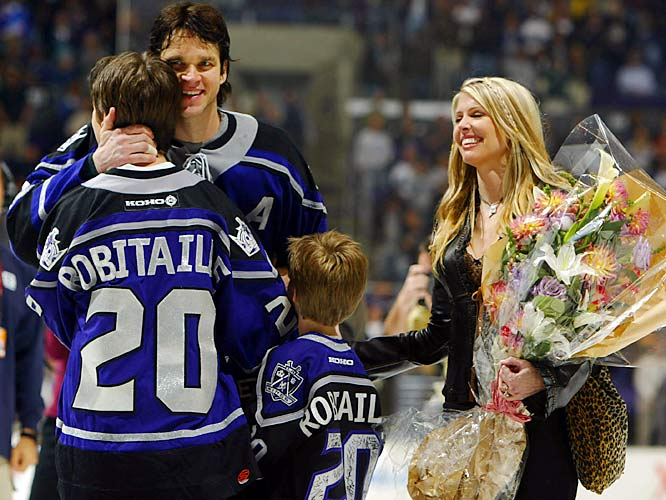 Robitaille signed with Los Angeles in 2003 and became the highest-scoring left winger in NHL history (1,394 points). The Kings honored him with a ceremony that included his wife Stacia and sons Steven and Jesse.