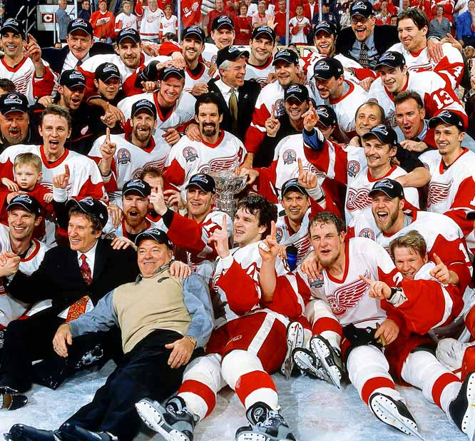 A five-game triumph over the Carolina Hurricanes in 2002 gave the Red Wings their third Stanley Cup in six years and the ninth in the legendary career of coach Scotty Bowman (front row, third from left).