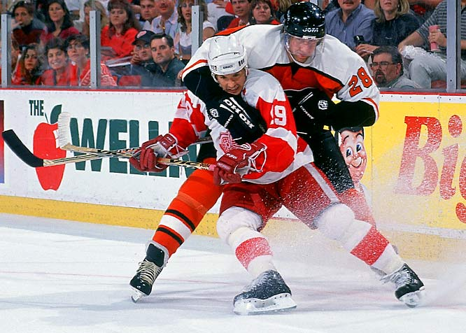 Yzerman and the Wings collided with the physical Philadelphia Flyers in the '97 Stanley Cup final. Here, Yzerman tangles with defenseman Kjell Samuelsson. The Captain sparked Detroit's furious sweep of Philadelphia with a game-winning slapshot in Game 1.