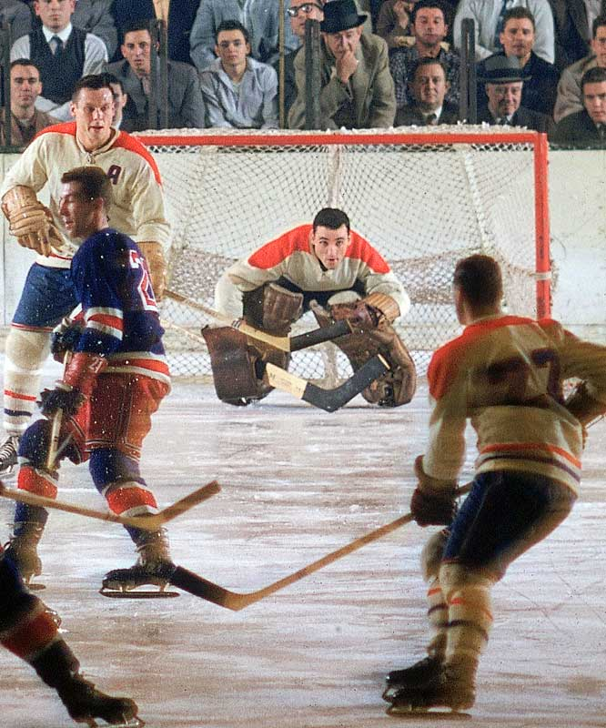 The father of the facemask was the first goalie to skate behind the net to play the puck and pass it in order to help his defense. Despite battling asthma, Jake The Snake won six Stanley Cups with Montreal and seven Vezina Trophies.