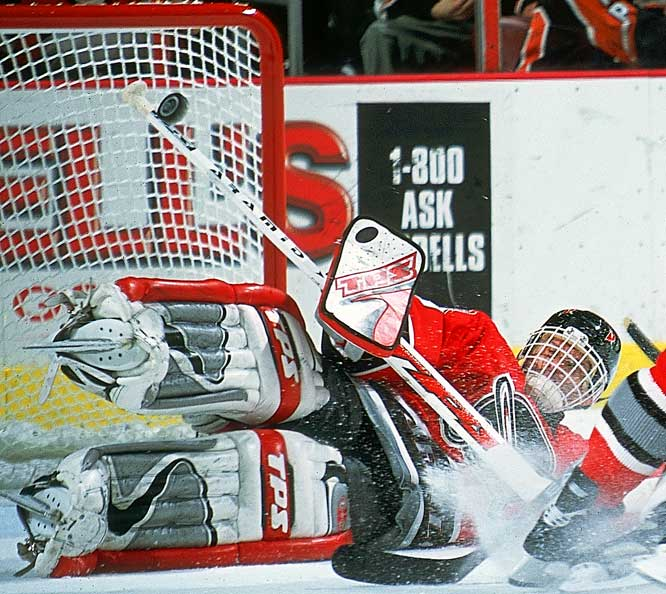 Acrobatic goalie is the only netminder to twice win the Hart Trophy as the NHL's MVP. Now in his 14th season, he has a career 2.21 GAA and one Stanley Cup (2002 with Detroit). Became a national hero in native Czech Republic after winning Olympic gold medal in 1998.