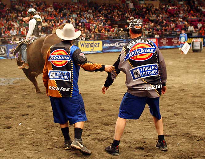 This may look like veteran bullfighter Frank Newsome is trying to pull me closer to the action, but it's just the opposite. Frank is holding onto me because he's scared to death. At least that's what I'm telling the grandkids someday.