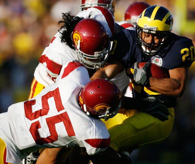 Linebacker Keith Rivers (55) helped the USC defense hold Michigan running back Mike Hart to 49 yards on 17 carries.