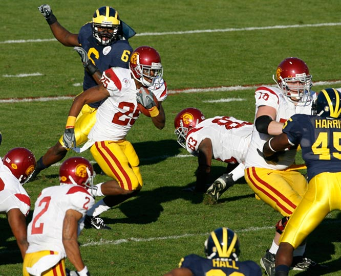 USC freshman tailback C.J. Gable, who finished with 26 rushing yards, picks his way through Michigan's defense.