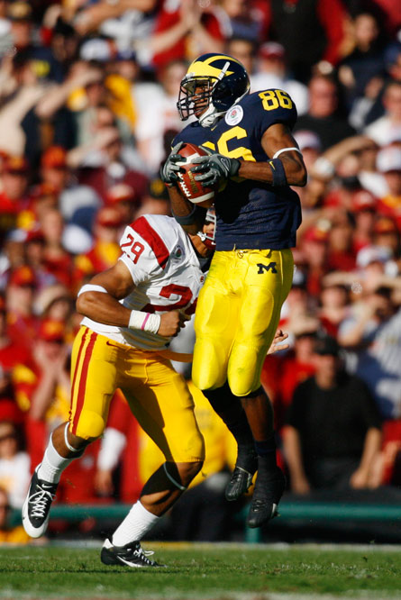 Michigan wide receiver Mario Manningham hauls in one of his seven receptions.