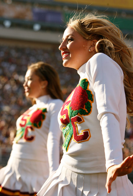 The Southern California cheerleaders lead the crowd in the Rose Bowl against Michigan.