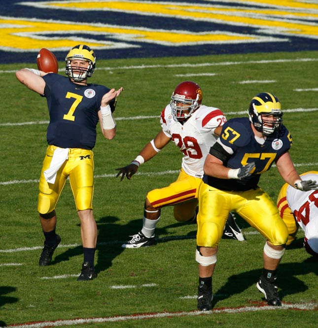 Chad Henne finished 27-for-42 for 312 yards, two touchdowns and an interception in the Wolverines' loss.