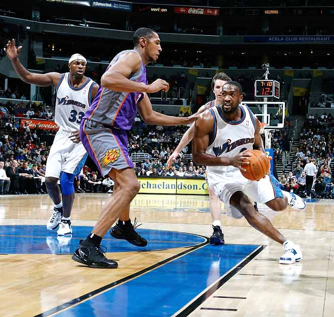Steve Nash (27 points on 11-13 shooting, 14 assists) outplays fellow MVP candidate Gilbert Arenas.