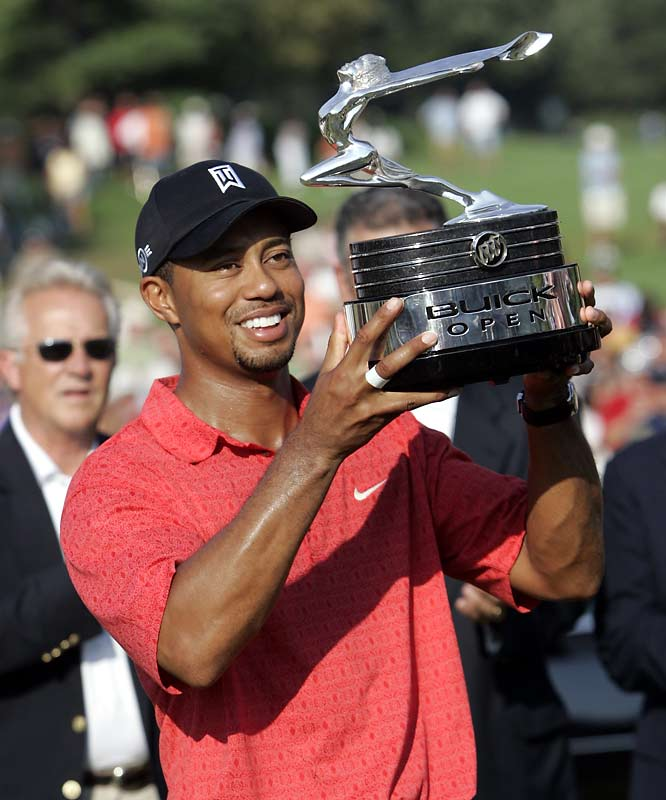 Four rounds of 66 gave Tiger a three-stroke win at Warwick Hills, Mich. At age 30, Tiger becomes the youngest Tour pro to reach 50 career wins.