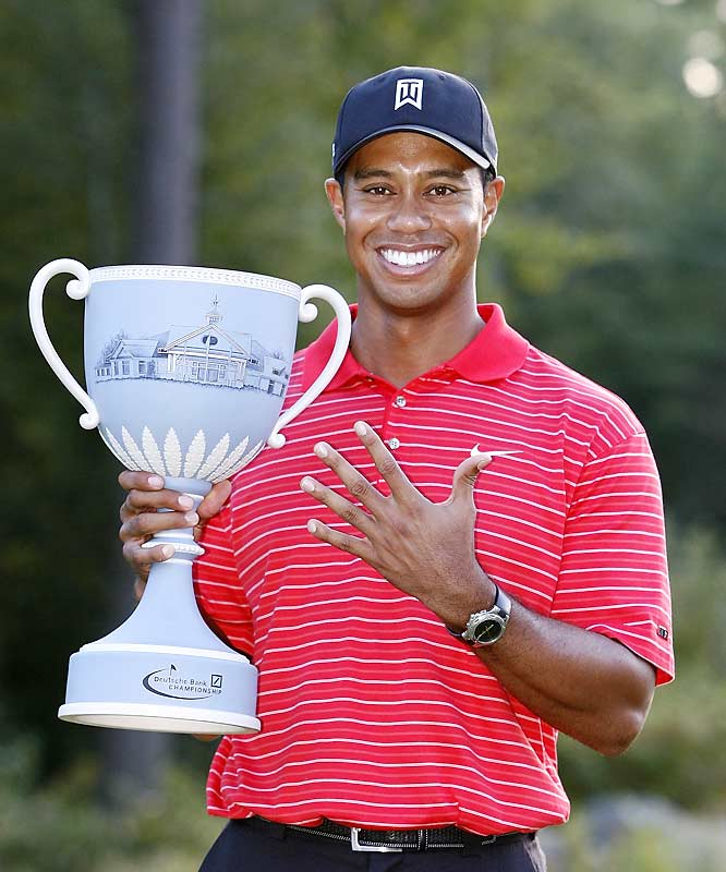 Tiger roared past Vijay Singh with a final-round 63 at the TPC Boston.