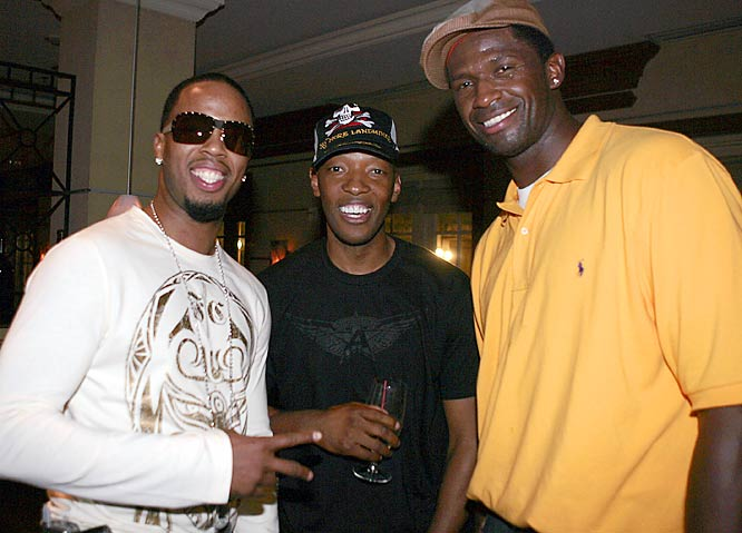 Sam Cassell and Antonio McDyess strike a pose with hip-hop star Keith Jones at a party hosted by James Posey last September.