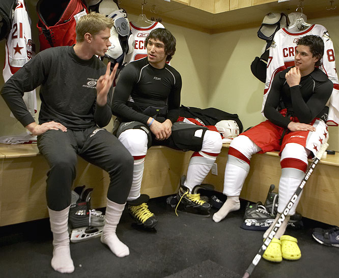Eric Staal (left), Alex Ovechkin (center) and Sidney Crosby talk it up in the locker room before their practice and team photo.