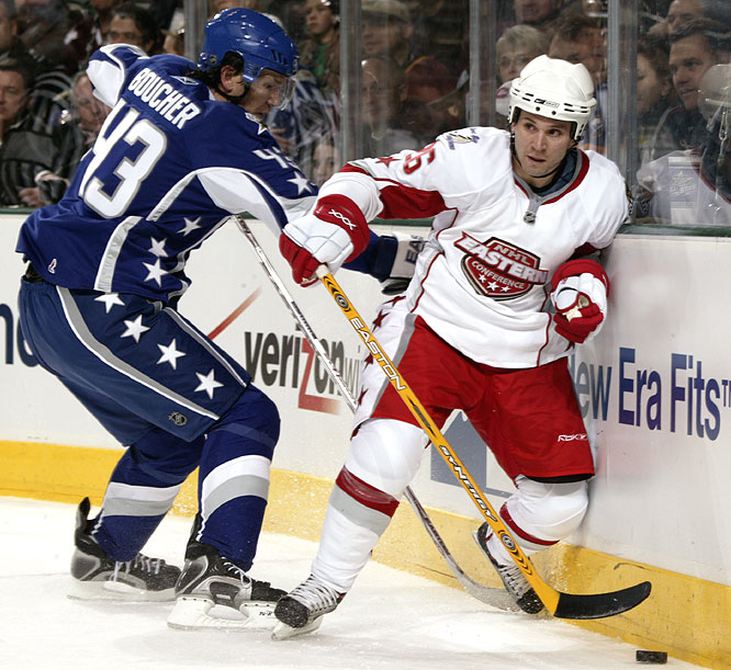 Martin St. Louis (right), who had a first-period goal, moves the puck away from defenseman Philippe Boucher.
