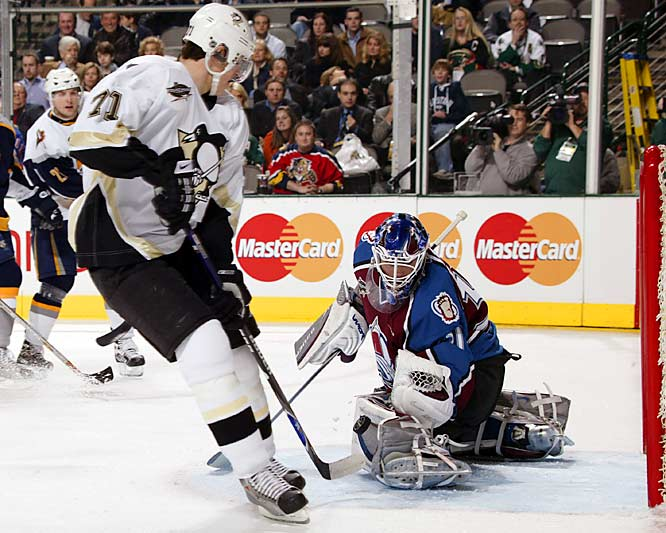 Penguins' rookie Evgeni Malkin loses the puck off of his stick before he can shoot it on Avs' goalie Peter Budaj. A favorite to win the Calder Trophy this season, Malkin was held without a point in the game.