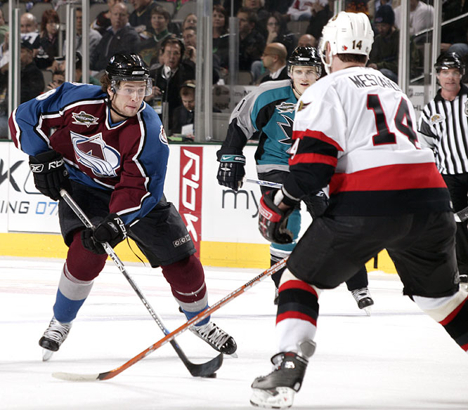The Avs' Wojtek Wolski tries to get around Ottawa's Andrej Meszaros during Tuesday's YoungStars game.