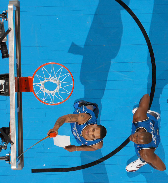 Orlando's Dwight Howard (right) also failed to make it past the opening round despite a dunk where he placed a sticker on the backboard that teammate Jameer Nelson that measured 12 feet, 6 inches off the ground.