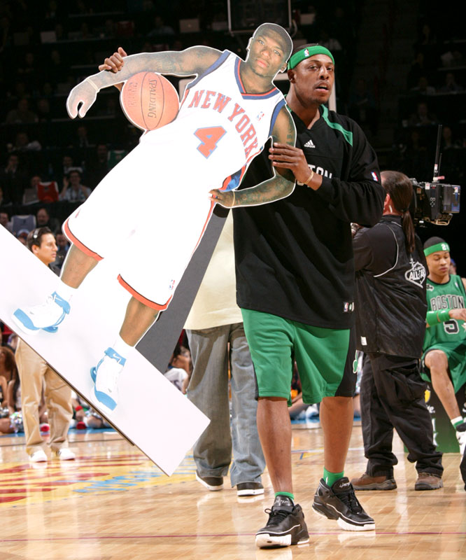 Gerald Green's teammate Paul Pierce (right) carred out a cardboard cutout of defending champ Nate Robinson for Green to dunk over ...