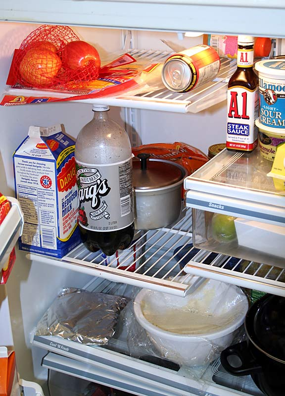"Halfway through our tour, it is time for a snack. Here's a look at the 'fridge. Whenever the food runs out, Spencer just goes back to his parents' place for a home-cooked meal. ""I love Phil, but he's not quite the cook my mom is,"" Hawes said."