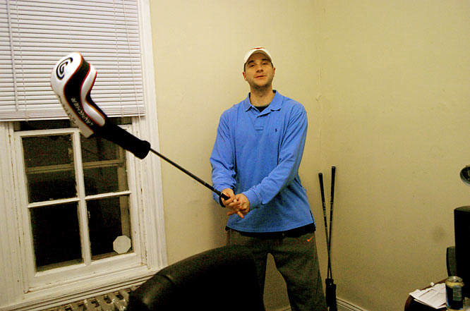 Brian shows off his flashy (and never-been used) set of golf clubs that have been propped up in a corner of his bedroom since he bought them.