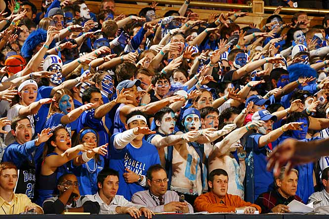 Duke students -- and their extended arms -- try to distract North Carolina early in the second half of Wednesday's ACC battle.