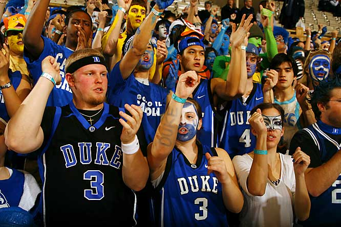 Duke students show off their Greg Paulus jerseys during Wednesday night's 79-73 loss to North Carolina.