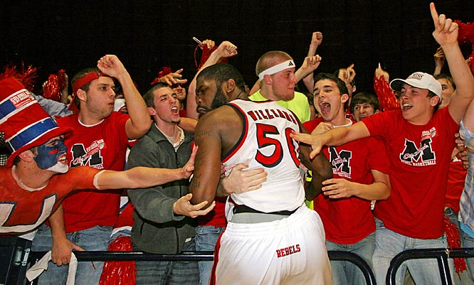 Mississippi forward Kenny Williams celebrates with fans after the Rebels defeated LSU, 71-70, on Wednesday.