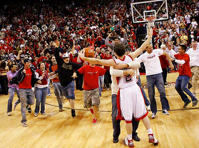 UNLV guard Kevin Kruge is mobbed by fans after the  	Runnin' Rebels defeated Air Force, 60-50, last Tuesday.