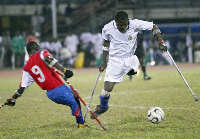Liberian defender Jimmy Harris takes control of the ball in a match against Ghana.