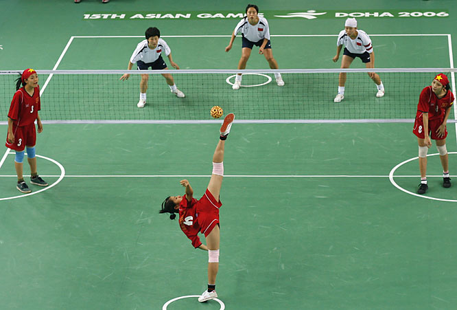 Vietnam's Thi Bich Thuy Nguyen (No. 6) serving against China in the women's Sepaktakraw team preliminaries.