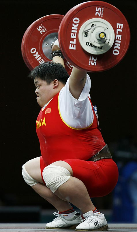 China's Mu Shuangshuang competes in the snatch part of the  75kg Group A competition.  She broke a world record and took first place in the section with a lift of 139Kg.