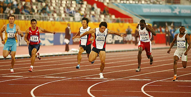 Yahya Hassan Habeeb (No. 432) of Saudi Arabia wins the gold in the men's 100. Also pictured are Thailand's Wachara Sondee (No. 738), Japan's Shigeyuki Kojima (No. 303), Japan's Naoki Tsukahara (No. 321), and Qatar's Alwaleed Abdulla A Abdulla (No. 644).