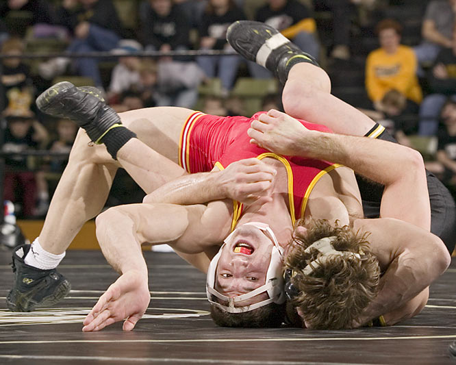 "Klutho's take:<br><br>""The funny thing about this is that he's actually pinning the guy from Missouri in this image. In wrestling images, you sometimes can't tell who is actually in control. But this is a clear pin.""<br><br> Shot with a Canon EOS-1DS"