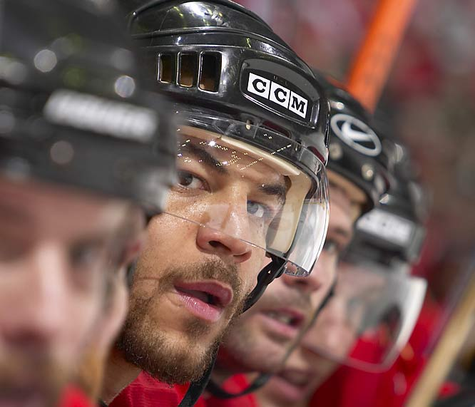 "Klutho's take:<br><br>""I was sitting between the benches when I captured this image of Iginla. I love how the heads of the players all line up with his. It's a tough angle because the players are moving and I was moving trying to line up the faces. I like that both of Iginla's eyes are in the image as well.""<br><br> Shot with a Canon EOS-1DS"