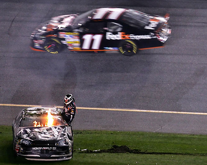 Clint Bowyer climbs out of his flaming car at the end of the Daytona 500.