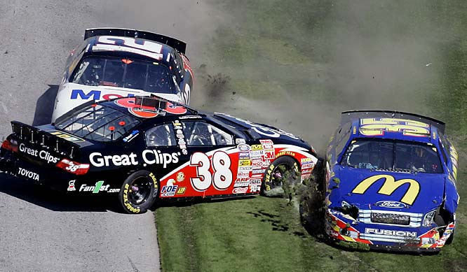 Jason Leffler (38) wipes out in between Sam Hornish Jr. (12) and Bobby Hamilton Jr. during the Busch 300.