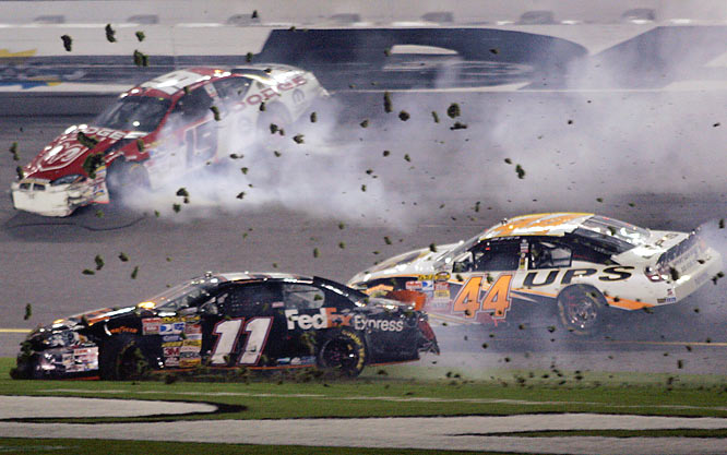 Denny Hamlin (11), Elliott Sadler (19) and Dale Jarrett (44) cross the finish line after a crash during the Budweiser Shootout.