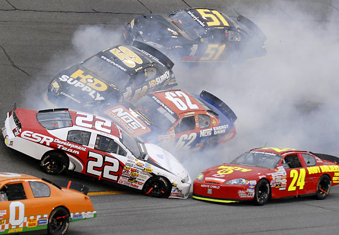 A jumble of cars pile up after Josh Wise (22) loses control during the ARCA 200 race.